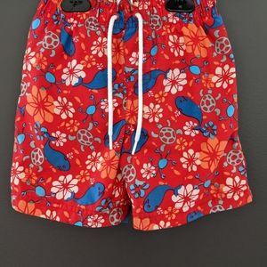 Red ocean print swim trunks